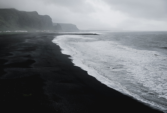 black beach sand is derived from dark volcanic parent rock material