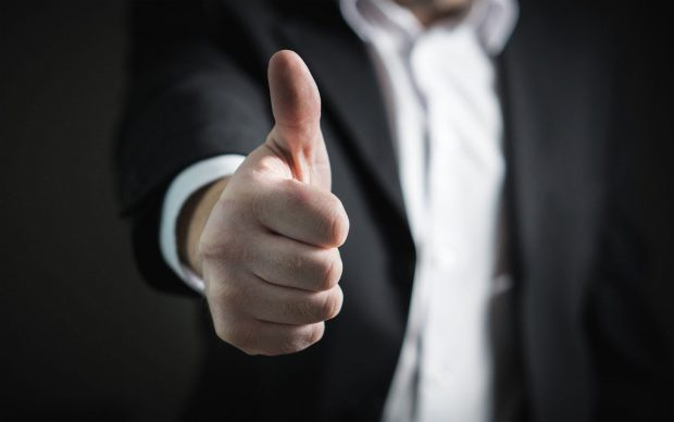 man closeup of thumbs up, highlighting that there is only one cannabis micro license in all of canaada approved