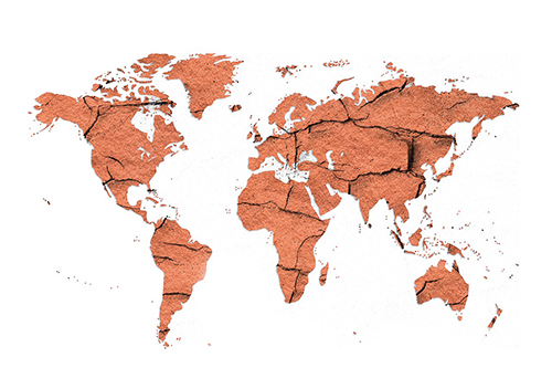 world map outline filled with exposed dry dirt illustrating the influence of global warming on soil erosion